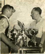 Gene Mangan and his Father Ted with trophies that Gene won.