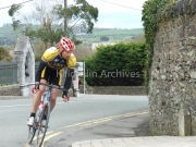 A Cyclist rounds the corner opposite St James Church Killorglin