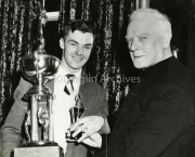 Gene Mangan, Receving a trophy from ?
