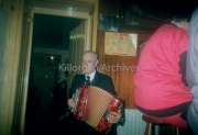Retired postman Mike Playing The Accordian Faces Of Killorglin