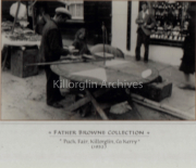 AUGUST 1932-THE SQUARE, KILLORGLIN, CO. KERRY, IRELAND. ROULETTE OPERATOR OUTSIDE THE JEWELLERS IN THE SQUARE. PICTURE DONATED BY WILLIE REILLY, LANGFORD STREET, KILLORGLIN.