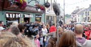 Crowds In The Square Watch A TV Recording During Puck Fair