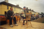 Pa Rochford and Patrick Doyle playing music at the Goat statue unveiling in Killorglin.