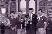 Sean Callaghan, ?, Billy McKenna, John Mangan outside the Railway Hotel.
