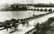 Old Photo of Killorglin with Church and Bridge in the backgroung and Donkey and Carts in foreground