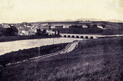 Killorglin before St. James Parish Church was build. The Bridge was completed in 1885. Work on the Church started in 1888 completed in 1891. This photo was taken in 1887
