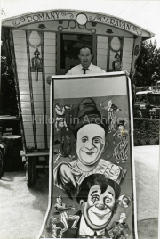 Patrick Houlihan outside his Romany Caravan with a 1910 Powell and Clarke Circus Poster.jpg