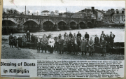 Under the shadow of the Laune Bridge at Killorglin, the fishermen of the K.R.D. firm pose for the traditional photograph taken in the early 1960's prior to the annual blessing of the boats.  January 17th is the official opening day for net salmon fishing in the River Laune.  Succeeding generations of the families seen here have manned the boats.  FR. Paddy Brick RIP, Michael Conway, Fr. Michael Stack, Jeremiah Mangan, Mangan, KRD, B Mangan, JJ Drugan, Inspector Water Keeper, Michael O'Sullivan, Clerk and Weighmaster, KRD, Tim Mangan, Tim Stack, BR. Danny Garvey, Batty Flynn, J Sheehan, John Reilly, Timothy Ferris, James McKenna, Thade Clifford, Michael Murphy, Thade Sheehan, Jack Murphy, Tim Griffin, Maurice McKenna, Eugene Mangan, willie Mangan, patrick Sullivan, Jer McKenna, Diarmuid Flynn, Sean ScKenna, Mick McKenna, Jerry Griffin, J McKenna, KRD is the name of the firm - founders of the Laune Fisheries. Ref: Kt057