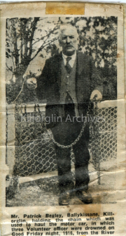 b/w photo of Patrick Begley, Ballykissane, Killorglin, holding the Chain which was used to haul the motor car in which three voulenteer officer were drowned on Good Friday night 1916, from the river Laune