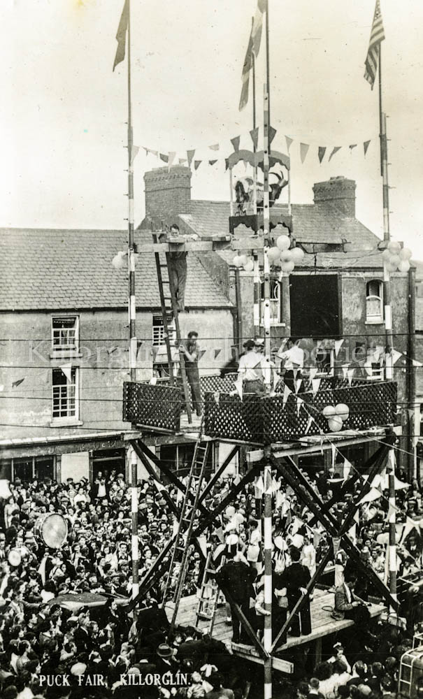 Pa Houlihan at the bottom of the ladder on the second tier of the at Puck Fair Stand, 1940's