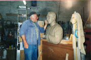 Alan Hall working on a bust of Fr. Tom Lawlor. 2001