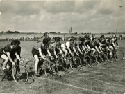 Gene mangan a Cycling sprint in a field